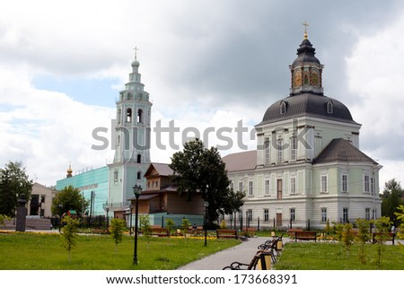 White and green orthodox church with grey domes  - stock photo