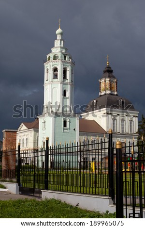 White and green orthodox church with grey domes