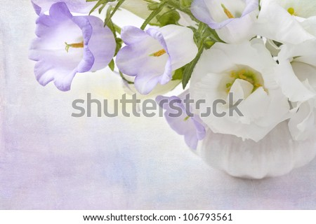 White and lilac flowers in a vase - stock photo