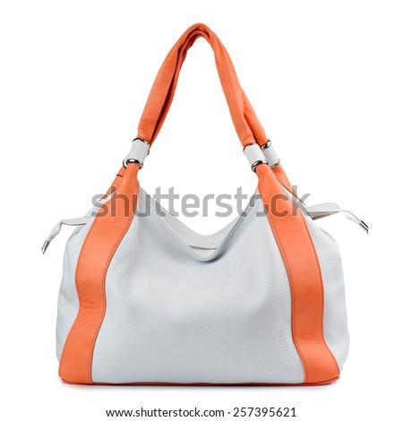 White and orange leather handbag isolated on white background - stock photo