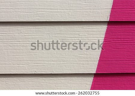 White and pink painted wood on a small house across from the ocean, nice texture and background, Tierra del Fuego - stock photo
