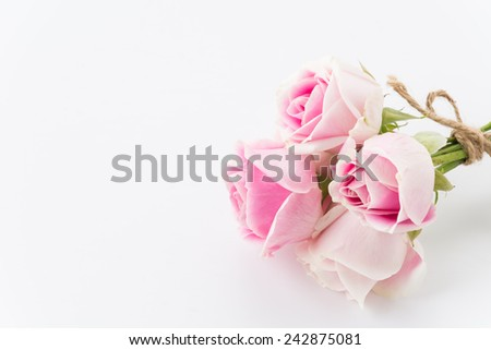 white and pink rose bouquet on white background