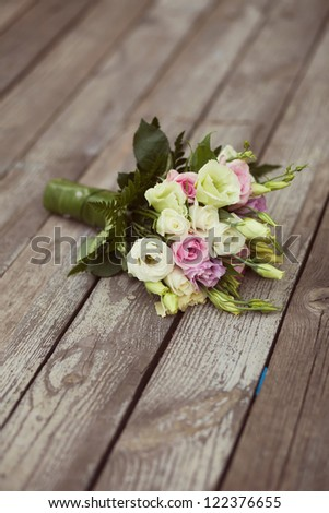 white and pink wedding bouquet in park - stock photo