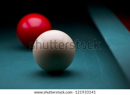 White and red carom balls with dark backgroud - stock photo