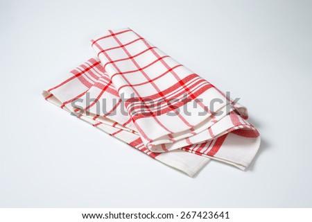white and red checkered dishtowel on white background - stock photo