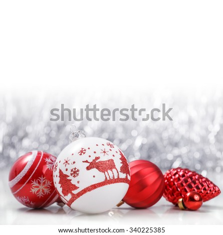 White and Red Christmas ornaments on glitter bokeh background with space for text. Xmas and Happy New Year theme