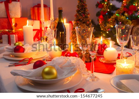 White and red decorations on the Christmas table - stock photo
