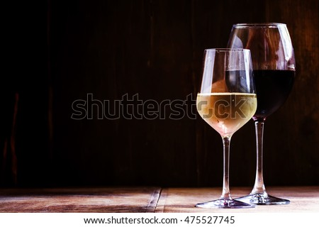 White and red dry wine, vintage wooden dark background, space for text, selective focus