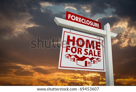 White and Red Foreclosure Home For Sale Real Estate Sign Over Beautiful Clouds and Sunset Sky. - stock photo