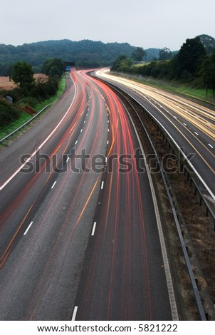 White and red light trails from long exposure photo off M6 - stock photo