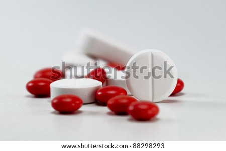 white and red pills isolated, selective focus - stock photo