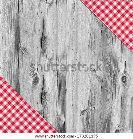 White and red tablecloth textile texture on wooden table background - stock photo