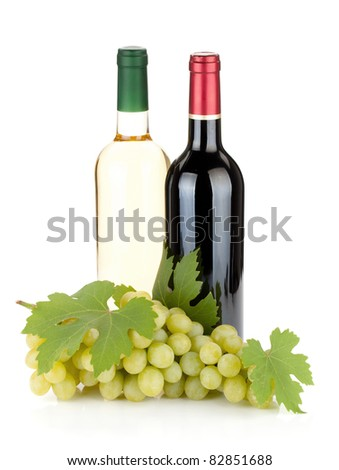 White and red wine bottles and grapes. Isolated on white background