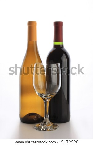 White and red wine bottles with an empty glass - stock photo