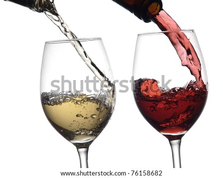 White and red wine pouring into two glasses - stock photo