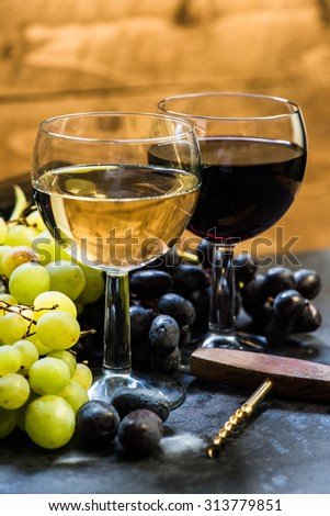 white and red wine with fresh grapes, wooden background - stock photo