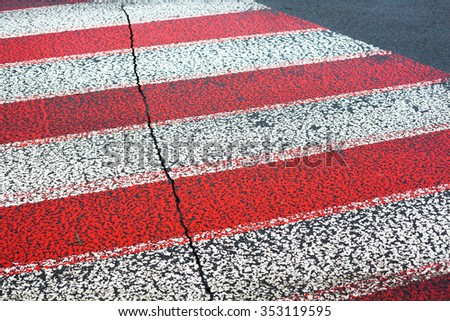 White and red zebra crossing lines on the road. - stock photo
