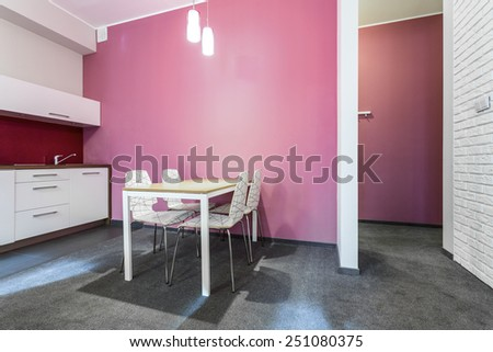 White and rose kitchen in small house - stock photo