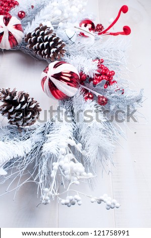 White and silver christmas wreath on the door - stock photo