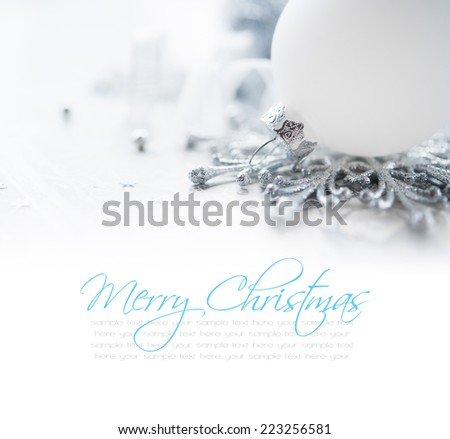 White and silver xmas decoration on holiday background with space for text. Merry christmas! - stock photo