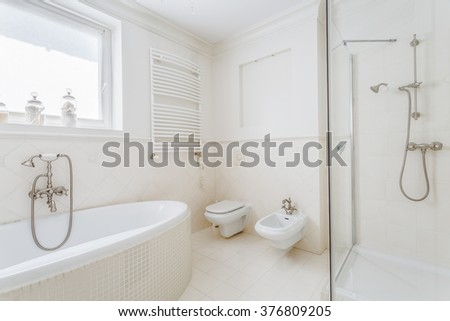 White and stylish bathroom in the house