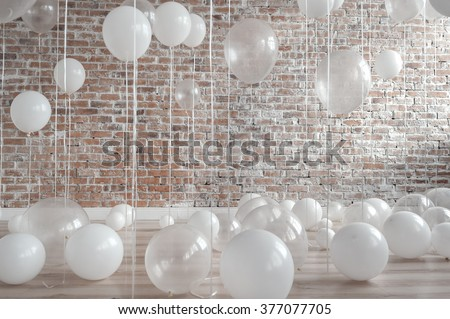 White And Transparent Balloons On Brick Wall Background - stock photo