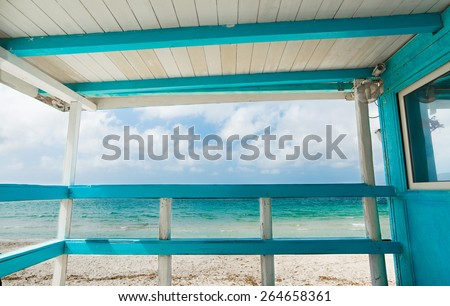 white and turquoise wooden terrace by the shore. Shot in Sardinia, Italy - stock photo