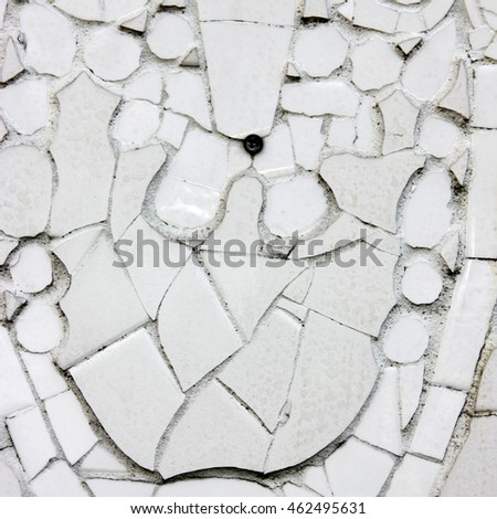 White and uneven decorative mosaic wall tiling