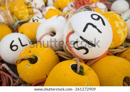White and yellow cray fishing buoys, Kingston, South Australia - stock photo