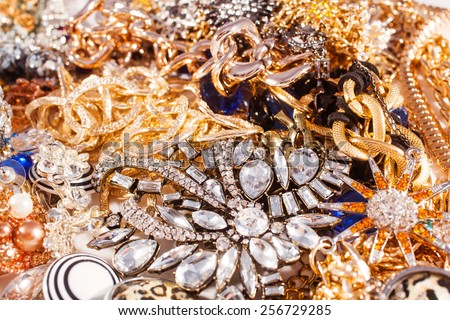 White and yellow gold jewelry background. Variety of jewels, precious background - stock photo