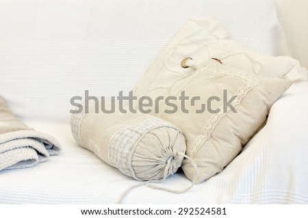 White and yellow pillow on bed - stock photo