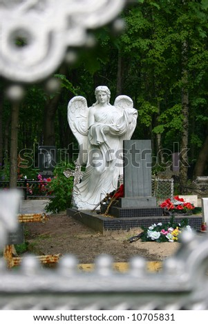 White Angel Cemetery monument view through cross - stock photo
