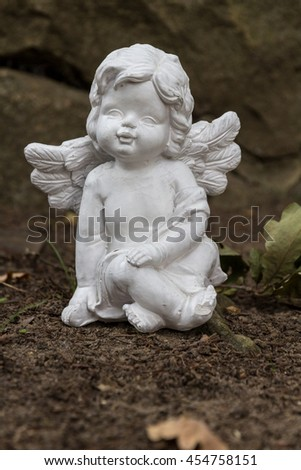 white angel figure sitting