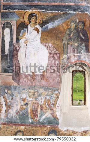 White Angel or Myrrhbearers on Christ's Grave is world famous fresco from the Mileseva monastery circa 1230 AD in Serbia, it depicts an angel sitting in front of the tomb of Christ - stock photo