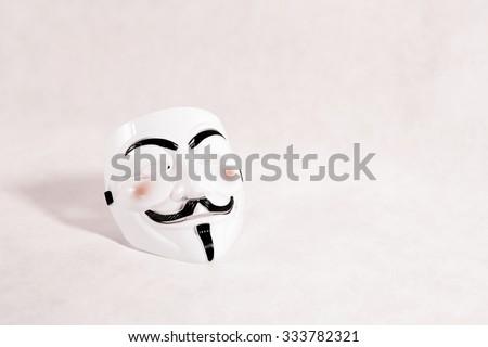 white anonymous mask on white background - stock photo