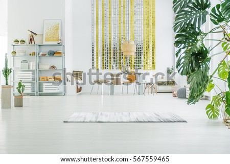 White apartment with metal bookcase  table  chairs and rug. Metal Furniture Stock Images  Royalty Free Images   Vectors