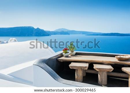 White architecture on Santorini island, Greece. Beautiful terrace with sea view - stock photo