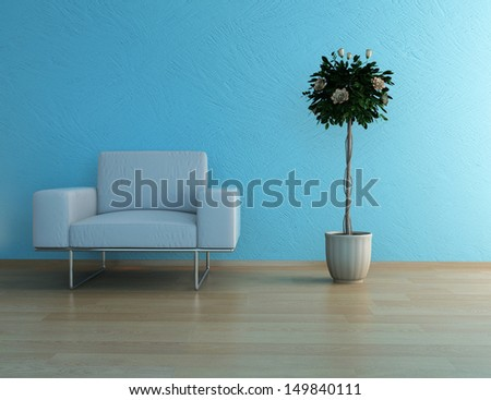 White armchair against blue wall with houseplant