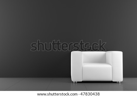 white armchair in front of black wall - stock photo