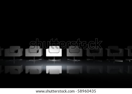 White armchairs on a black background with light effect - stock photo