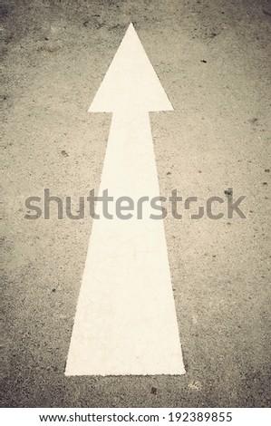 White arrow direction on road,  - stock photo