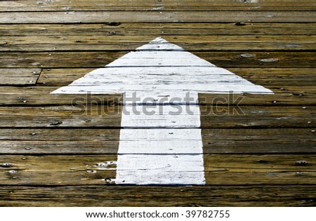 White Arrow Painted on Wooden Planks - stock photo
