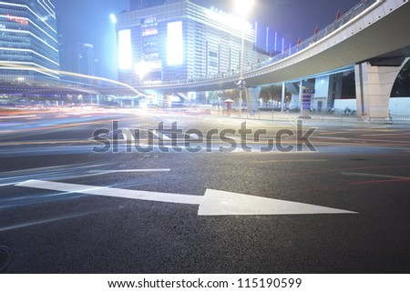 white arrow road sign at lujiazui business center,shanghai - stock photo