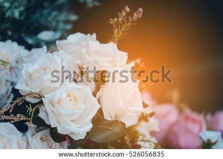 White Artificial rose flower in vintage tone
