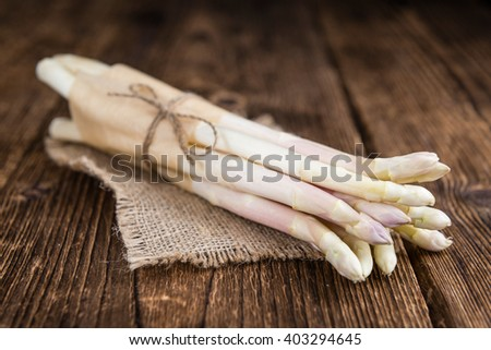 White Asparagus (selective focus) on wooden background (close-up shot) - stock photo