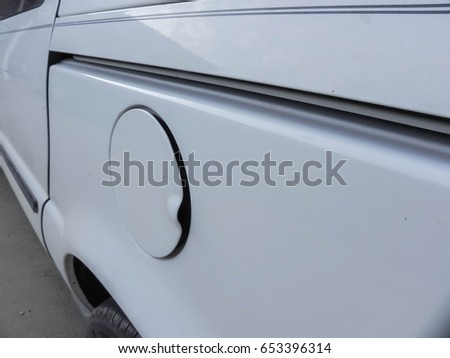 White automobile gas cap closed