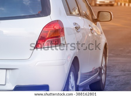 White back car on the street, driving on road - stock photo