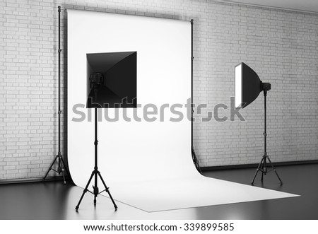 White background lit with Studio equipment against a brick wall. 3d rendering. - stock photo