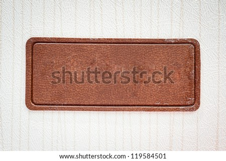 White background with a brown label.