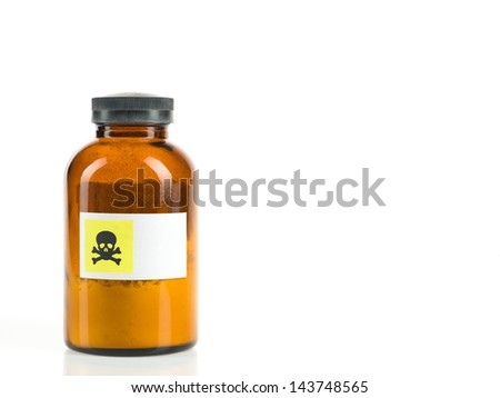 white background with small brown transparent bottle containing a powder and labeled with a warning for toxicity - stock photo